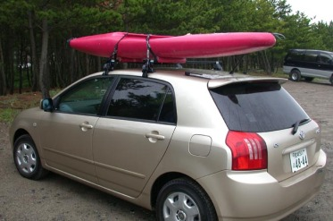 car and river kayak